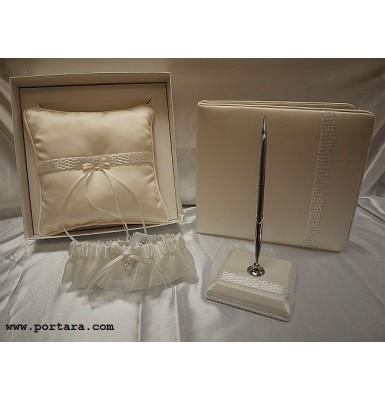 An Ivory Pearl Beauty Guest Book, Pen, Pillow and Garter Set